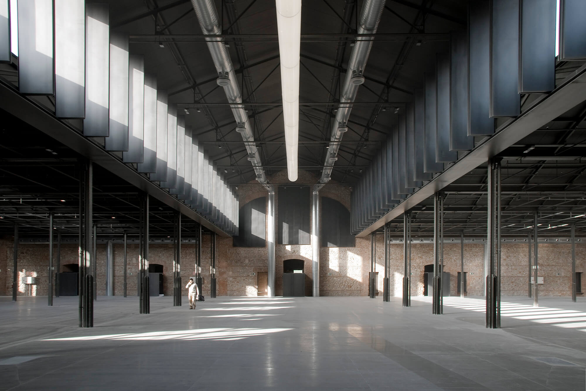 Hangar 16 offers space for a variety of cultural and creative activities, such as exhibitions that utilise defunct carcass-hanging hooks to display delicate pieces of art.